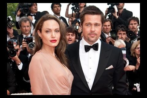 """(L-R) Actress Angelina Jolie and actor Brad Pitt arrive at the premiere of """"Inglorious Basterds"""" at the 62nd Cannes Film Festival in Cannes."""